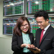 Strong stock market gives securities firms profit a boost in Q3
